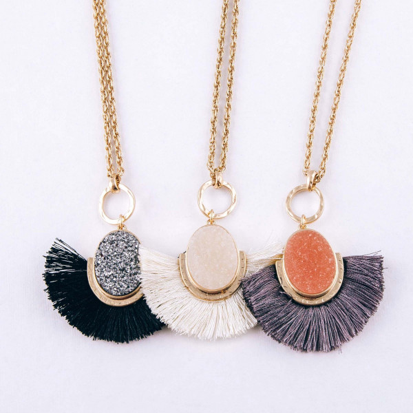 "Long druzy encased tassel pendant necklace. Pendant approximately 2.5"" in length. Approximately 34"" in length overall."