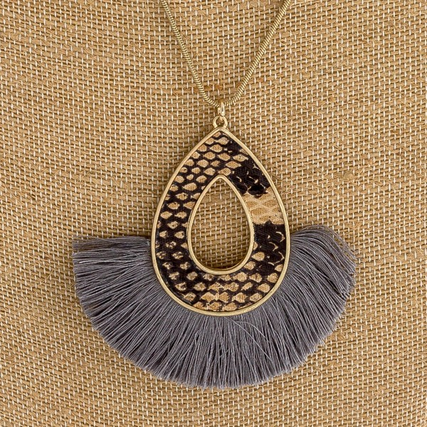 """Faux leather snakeskin encased teardrop pendant necklace with tassels. Pendant approximately 3"""" in length. Approximately 36"""" in length overall."""