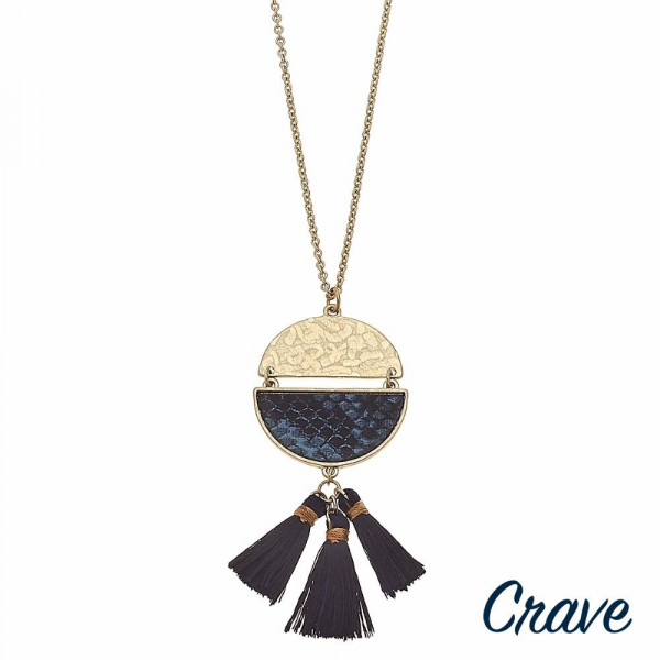 """Long metal encased faux leather snakeskin half moon linked pendant necklace with tassel accents. Pendant approximately 3.5"""" in length. Approximately 36"""" in length overall."""