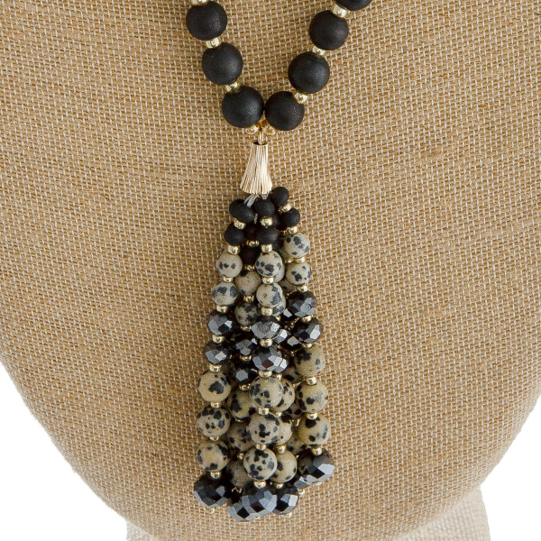 """Long wood beaded necklace featuring natural stone beaded tassel pendant. Pendant approximately 4"""" in length. Approximately 38"""" in length overall."""