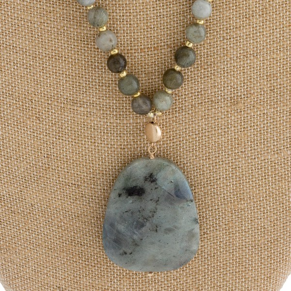 "Semi precious beaded natural stone pendant necklace with wood accents.   - Pendant approximately 2"" in length  - Approximately 16"" in length overall"