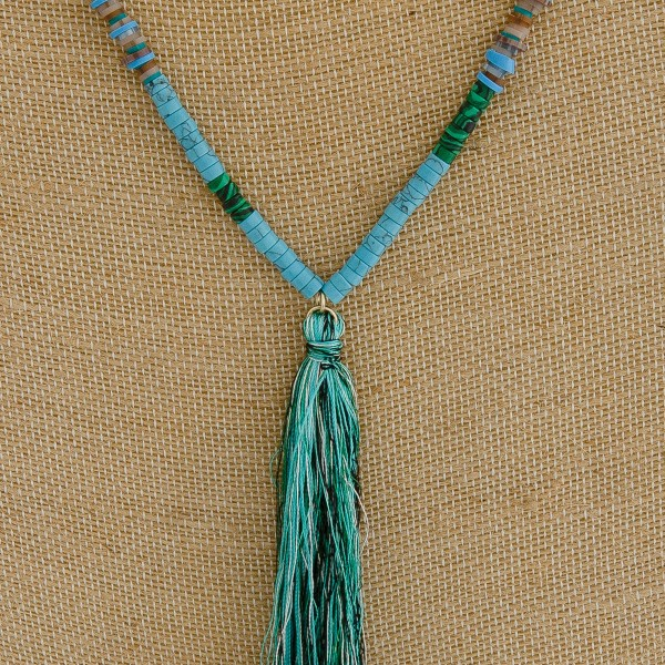 """Natural stone accented seed/spacer beaded tassel necklace.   - Tassel approximately 5.5"""" L - Approximately 40"""" in length overall"""