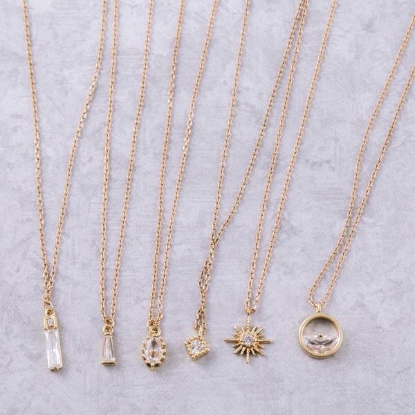 "Dainty gold cubic zirconia necklace.  - Pendant approximately 5mm in length - Approximately 14"" in length with 2"" extender"