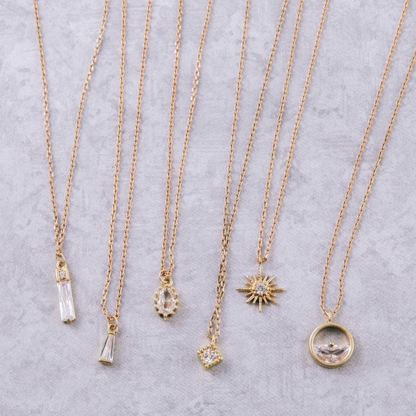 """Dainty gold cubic zirconia necklace.  - Pendant approximately 5mm in diameter - Approximately 14"""" in length with 2"""" extender"""