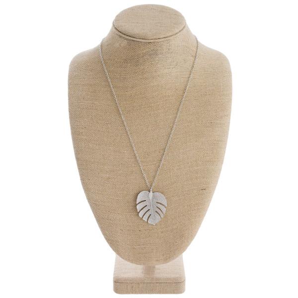 "Long filigree leaf pendant necklace. Pendant approximately 2"" in length. Approximately 28"" in length overall."