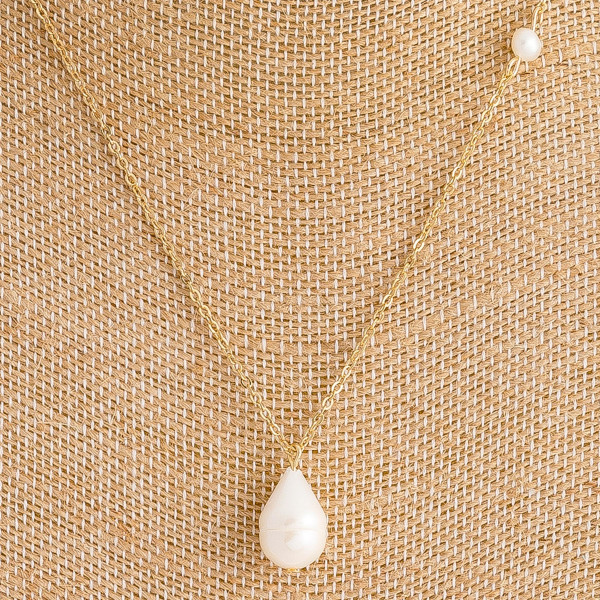 "Dainty freshwater pearl necklace. Approximately 16"" in length."