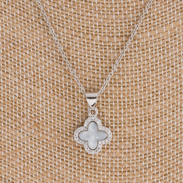 "Dainty resin clover pendant featuring cubic zirconia details. Pendant approximately 1cm in diameter. Approximately 16"" in length."