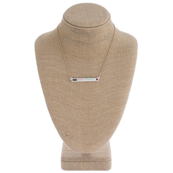 "Christmas ""Merry Christmas"" bar necklace. Pendant approximately 2"" in length. Approximately 16"" in length overall."