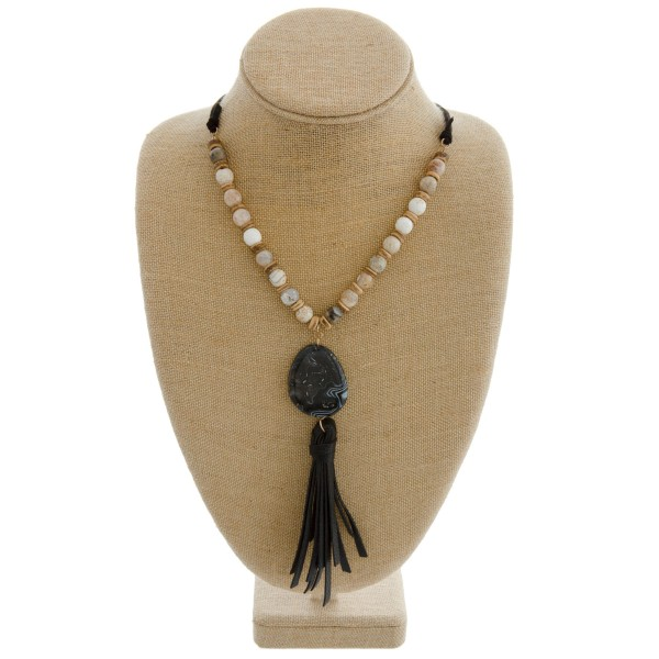 """Semi precious beaded faux leather necklace with natural stone tassel pendant. Pendant approximately 6.5"""" in length. Approximately 44"""" in length overall."""