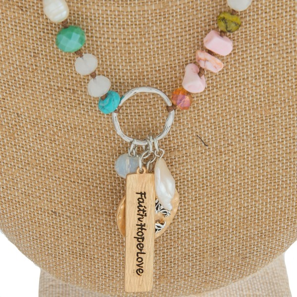 """Long semi precious beaded necklace featuring an inspirational charm pendant with """"Faith Hope Love"""" engraved details.  - Pendant approximately 2.25"""" in length - Approximately 34"""" in length overall"""