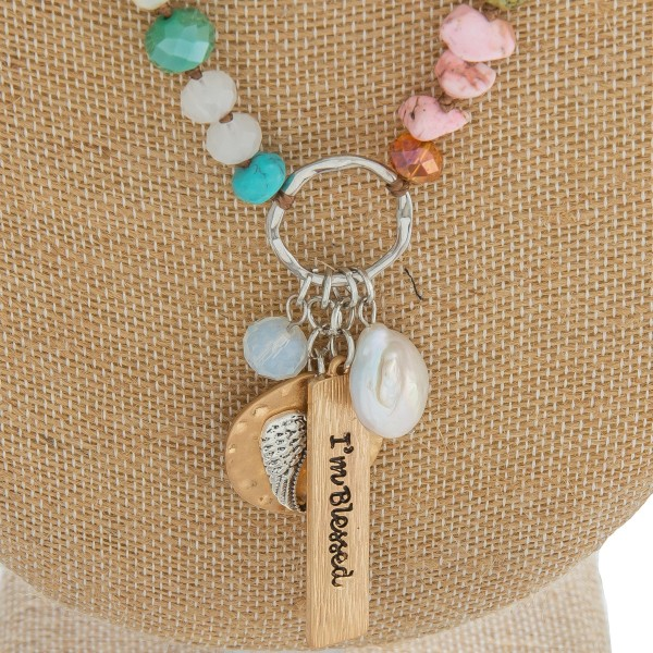 """Long semi precious beaded necklace featuring an inspirational charm pendant with """"I'm Blessed"""" engraved details.  - Pendant approximately 2.25"""" in length - Approximately 34"""" in length overall"""