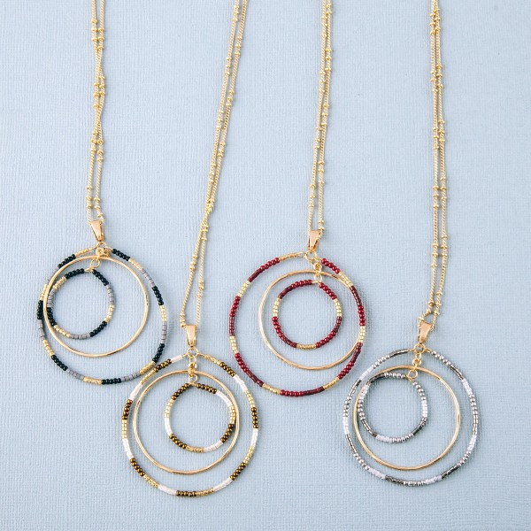 """Long seed beaded nested open circle pendant necklace.  - Pendant approximately 2"""" in diameter  - Approximately 34"""" in length overall with 3"""" extender"""