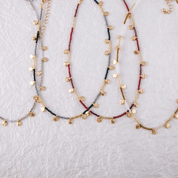 """Seed beaded gold disc accented boho necklace.  - Approximately 14"""" in length with 3"""" extender"""