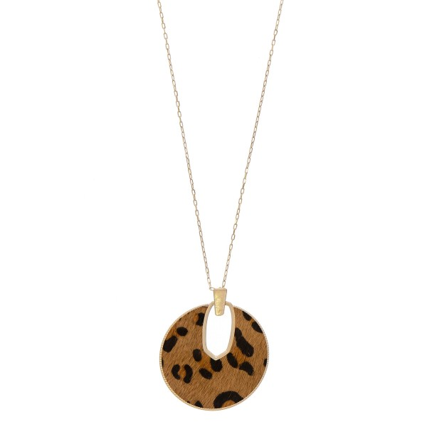 """Cowhide leopard print encased disc pendant necklace.  - Pendant approximately 2.5"""" in diameter - Approximately 34"""" in length overall"""
