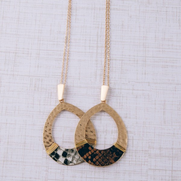 """Hammered teardrop pendant necklace with snakeskin and wire wrapped details.  - Pendant approximately 3"""" in length - Approximately 36"""" in length overall with 3.5"""" extender"""