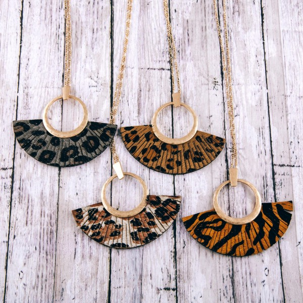 """Faux leather cowhide animal print tassel pendant necklace.  - Pendant approximately 3"""" in length - Approximately 36"""" in length overall"""