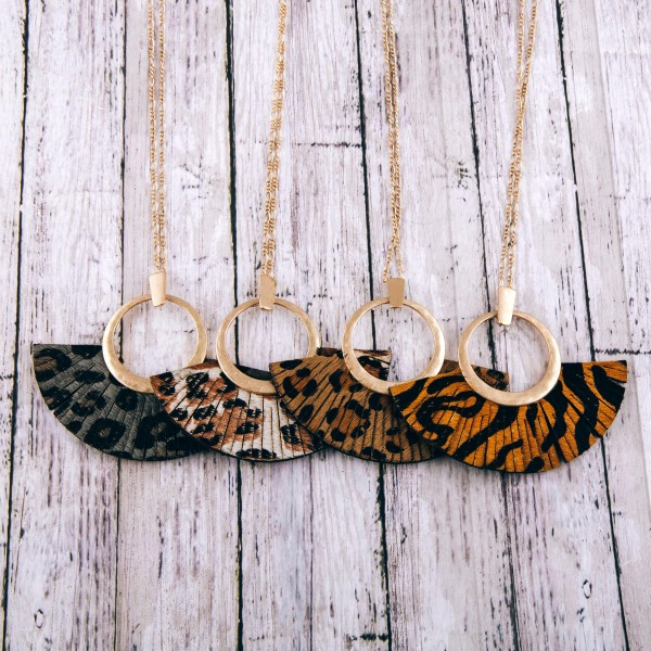 """Faux leather cowhide leopard print tassel pendant necklace.  - Pendant approximately 3"""" in length - Approximately 36"""" in length overall"""