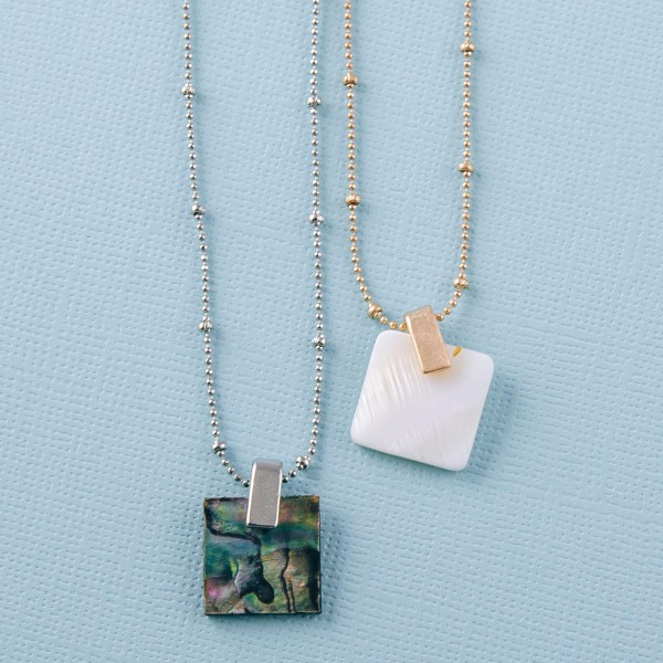 "Genuine resin Mother of Pearl pendant necklace.  - Pendant approximately .5"" x .5""  - Approximately 16"" in length overall with 3"" extender"