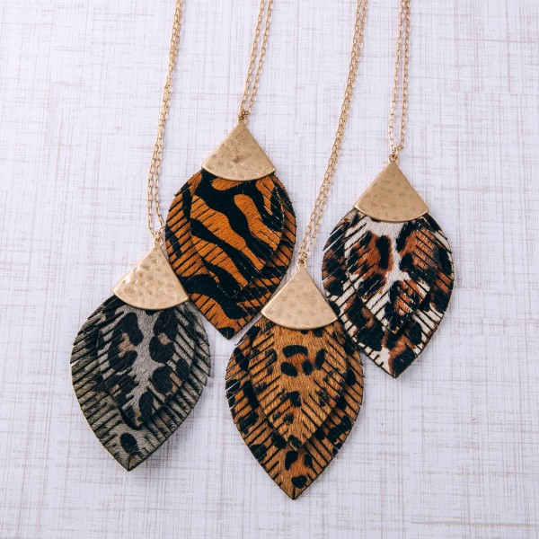 """Long doubled genuine leather leopard print feather pendant necklace.  - Pendant approximately 3.5"""" in length - Approximately 36"""" in length overall with 3"""" extender"""