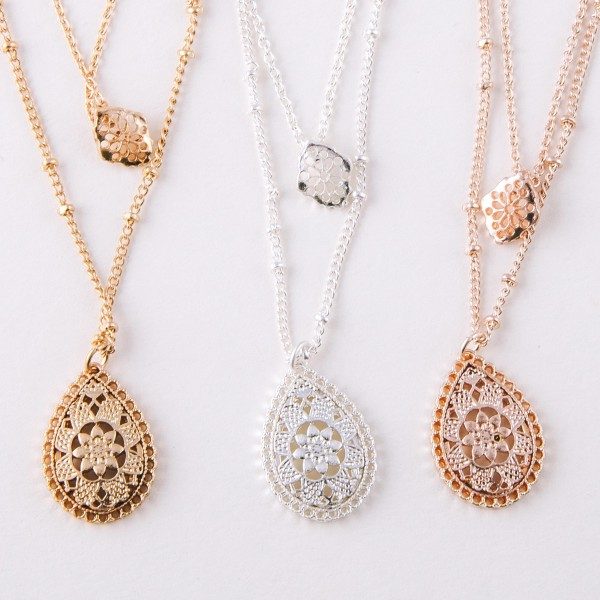 """Layered filigree flower teardrop pendant necklace.  - Pendant approximately .75"""" in length - Shortest layer approximately 12"""" in length - Approximately 16"""" in length overall with 3.5"""" extender"""