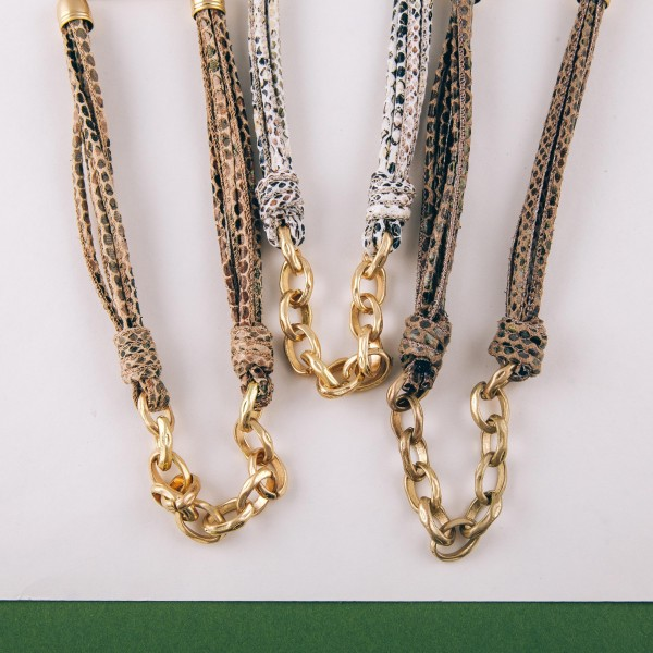 """Bulky faux leather snakeskin cord gold chain linked necklace.  - Approximately 16"""" in length with 3"""" extender"""
