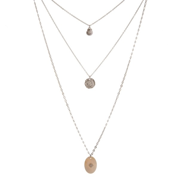 "Long layered mother of pearl shell necklace.   - Shortest layer 16""  - Approximately 30"" in length overall with 2"" extender"