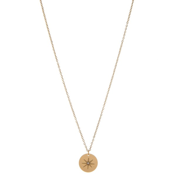 """Gold north star disc pendant necklace with rhinestone accent.  - Pendant approximately .5"""" in diameter - Approximately 16"""" L - 2.5"""" extender"""