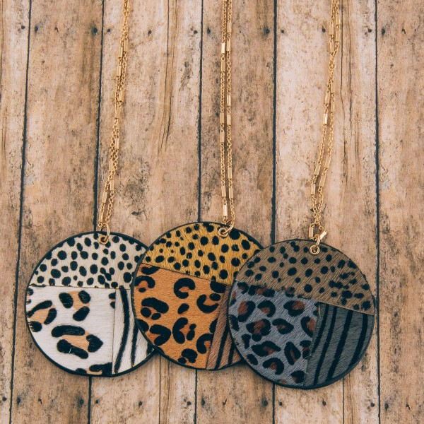 """Long genuine leather double sided animal print disc pendant necklace.  - Pendant approximately 2"""" in diameter - Approximately 34"""" in length overall with 3"""" extender"""