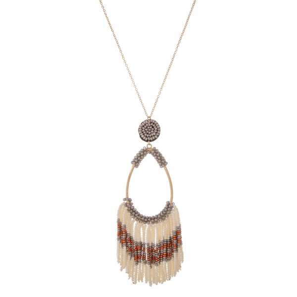 "Long gold seed beaded fringe tassel pendant necklace.  - Pendant approximately 4.5"" in length - Approximately 36"" in length overall with 3"" extender"