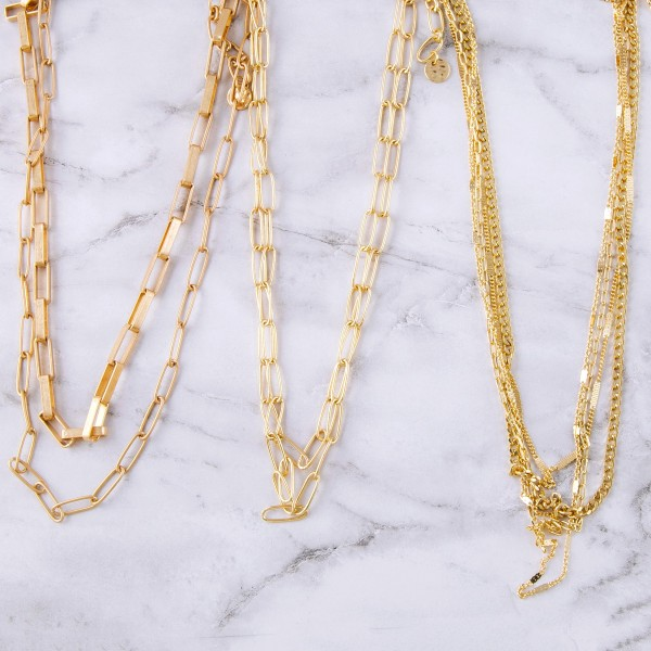"""Multi gold layered chain link necklace.  - Shortest layer approximately 14"""" in length - Approximately 18"""" in length overall with 3"""" extender"""