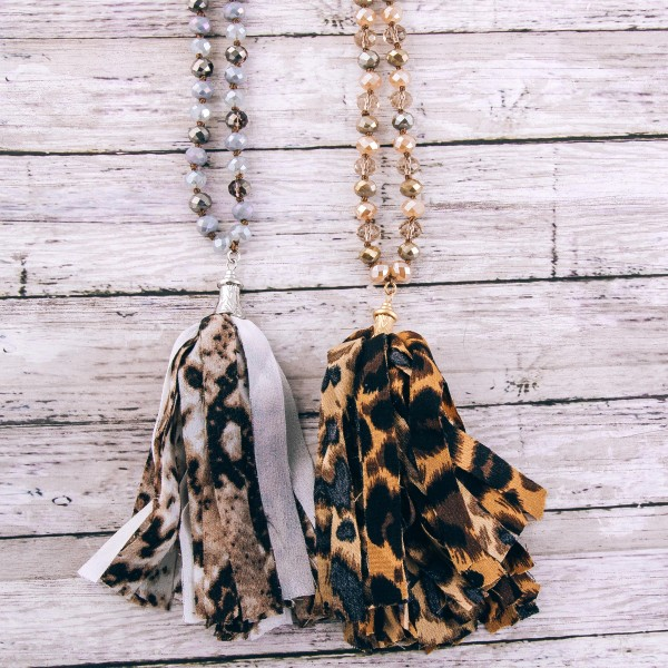 """Long beaded leopard print fabric tassel statement necklace.  - Pendant approximately 5""""  - Approximately 40"""" L  - 3"""" extender"""