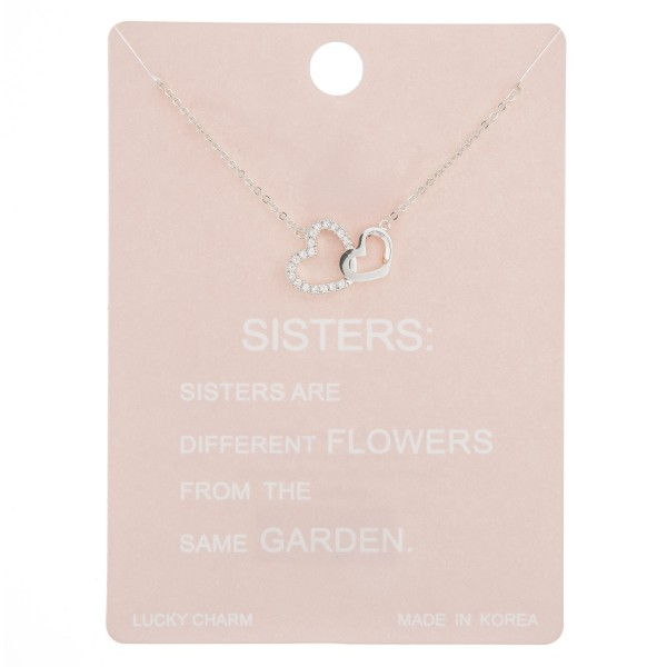"Dainty rhinestone ""Sister's are Forever"" heart lucky charm necklace.  - Pendant approximately .5""  - Approximately 16"" in length with 2"" extender"