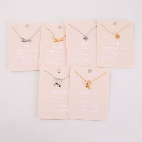 """Dainty love script lucky charm necklace.  - Pendant approximately .5""""  - Approximately 16"""" in length with 2"""" extender"""