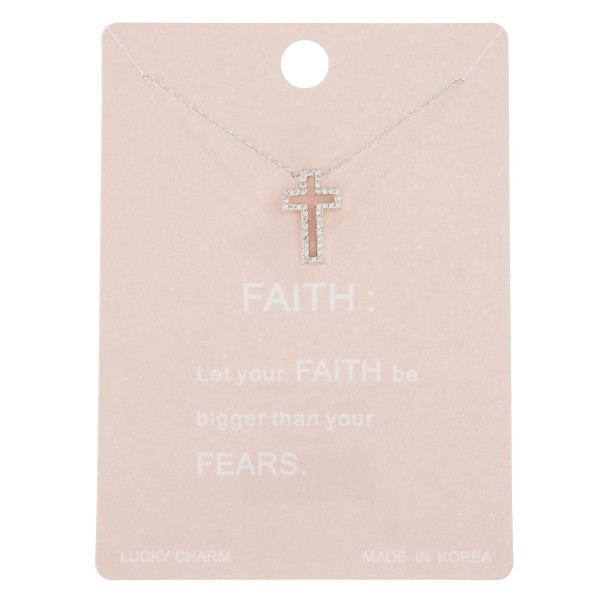 "Dainty rhinestone cross lucky charm necklace.  - Pendant approximately .5""  - Approximately 16"" in length with 2"" extender"