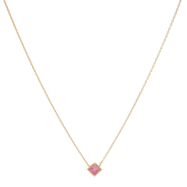 "Gold dipped cubic zirconia pendant necklace.  - Cubic Zirconia - Pendant approximately 5mm - Approximately 16"" in length with 2"" extender"