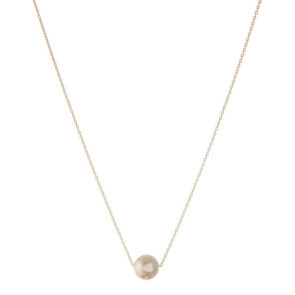 "Gold dipped faux pearl necklace.  - Pearl size approximately 9mm - Approximately 15"" in length with 2"" extender"