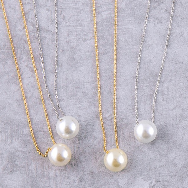 "White Gold dipped faux pearl necklace.  - Pearl size approximately 9mm - Approximately 15"" in length with 2"" extender"