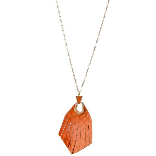 "Long Worn Gold Genuine Leather animal print hinge tassel pendant necklace.  - Pendant approximately 2.75""  - Approximately 32"" L - 3"" extender"