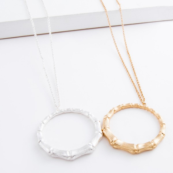 """Long Worn Gold bamboo disc pendant necklace.  - Pendant approximately 2"""" in diameter - Approximately 32"""" L overall - 3"""" extender"""