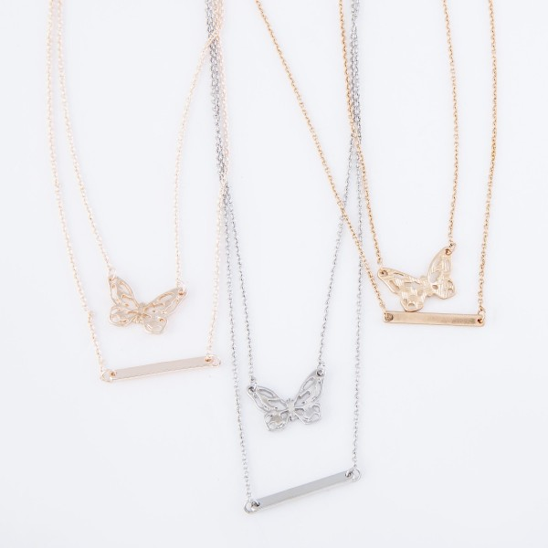 "Double layered chain necklace featuring a butterfly pendant and a metal bar accent.  - Approximately 16"" L with a 3"" extender"
