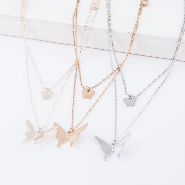"Short Double layered gold necklace with butterfly pendants.  - Shorter chain measures approximately 14"" L & longer chain measures approximately 17"" L  - Features a 3.5"" extender"
