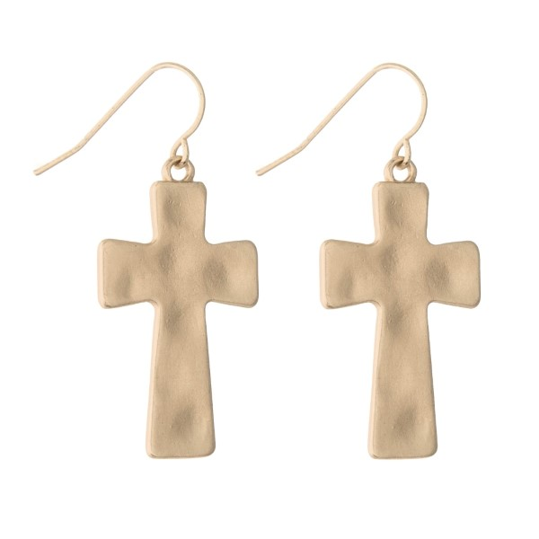 "Matte gold toned hammered cross earrings. Approximate 1.25"" in length."
