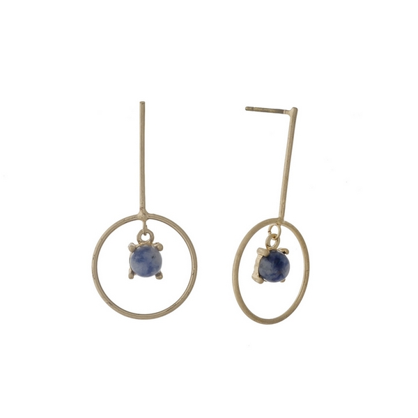 "Dainty, gold tone post style earrings with a blue stone. Approximately 1.25"" in length."
