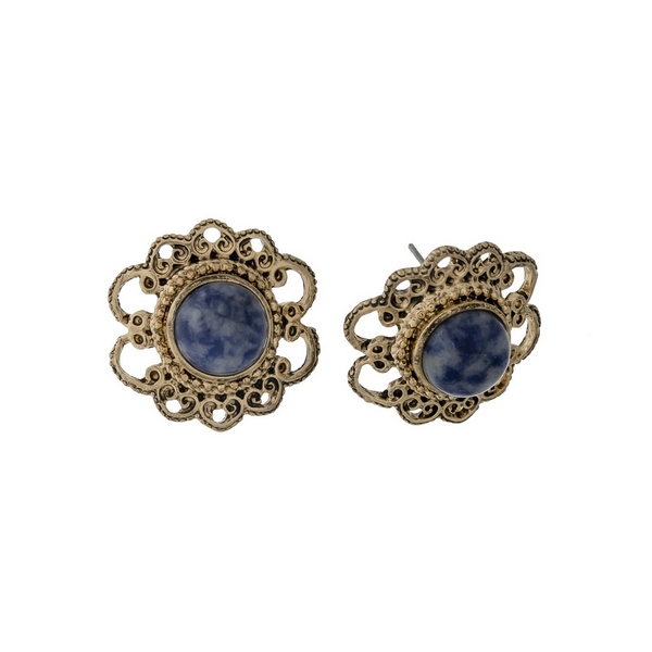 "Burnished gold tone, flower shaped, stud earrings with a blue stone. Approximately 1"" in length."