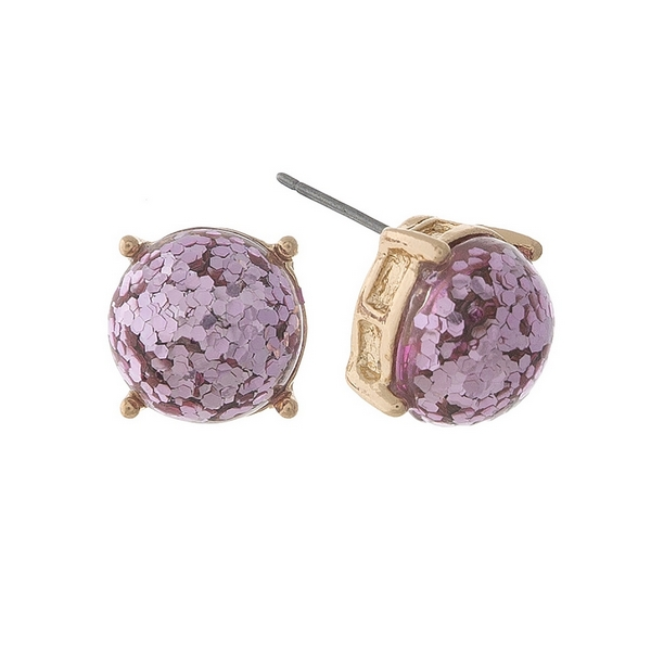 "Gold tone stud earrings with pink glitter. Approximately 1/3"" in diameter."