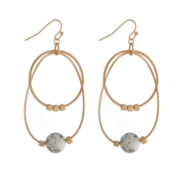 """Gold tone fishhook earrings with two open circles and gold tone and howlite natural stone beads. Approximately 2"""" in length."""