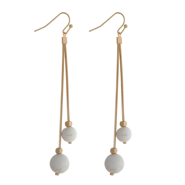 "Gold tone fishhook earrings with two howlite natural stone beads. Approximately 3"" in length."