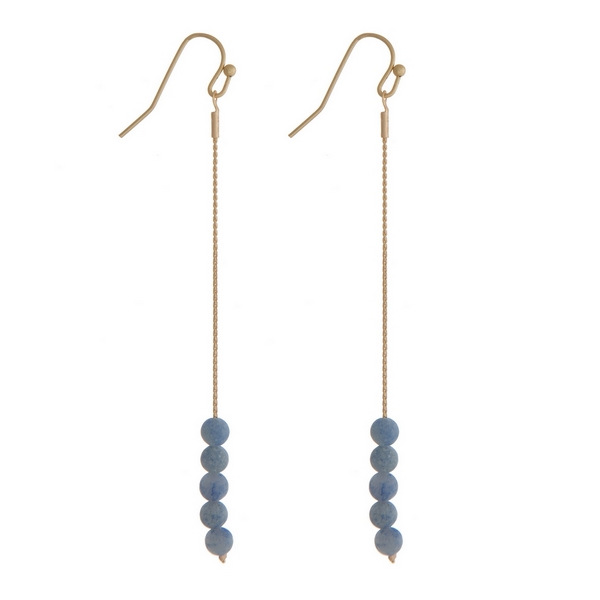 """Gold tone fishhook earrings with blue natural stone beads. Approximately 3"""" in length."""