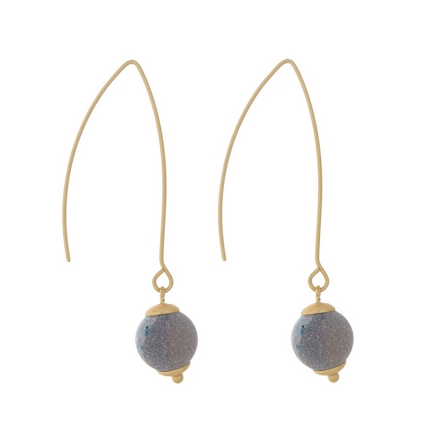 "Matte gold tone long hook earrings with a gray natural stone bead. Approximately 2"" in length."