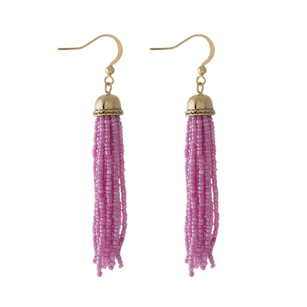 "Gold tone fishhook earrings featuring a fuchsia beaded tassel. Approximately 3"" in length."